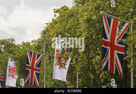 2012 London Oylmpic Games flag and Union Jack flag hanging in the Mall London England 2008 - Stock Photo