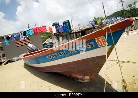 Fishing boat and washing line on the beach, Anse la Raye, St Lucia, 'West Indies' - Stock Photo