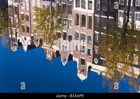 Holland, Amsterdam, traditional Gabled houses reflected in canal - Stock Photo