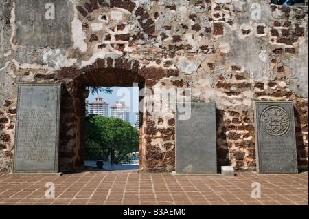 Looking at the past with a window to the future - Old Dutch tombstones in the ruins of the Portuguese built St. - Stock Photo