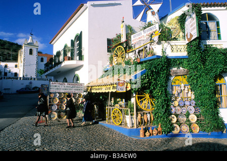 Portugal.  Typical tourist pottery shop in the Algarve village of Alte. - Stock Photo