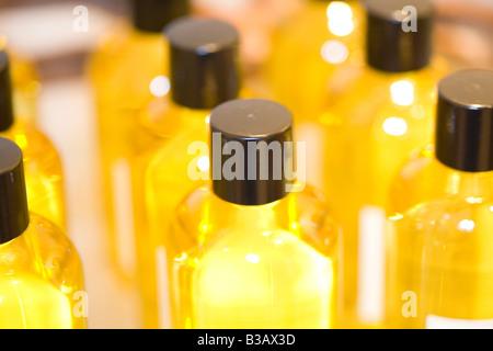 Massageoel in einer Flasche, massage oil in small bottles - Stock Photo