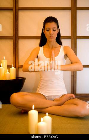 Frau bei einer Yoga Uebung, young woman doing yoga - Stock Photo