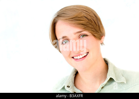 Attractive young woman smiling. - Stock Photo