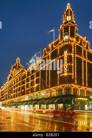 Harrods at night, Knightsbridge, London, England UK - Stock Photo
