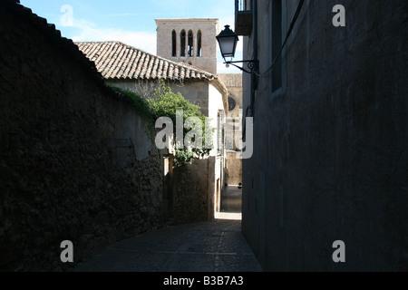 Narrow shadowed streets in Cuenca, Spain. - Stock Photo