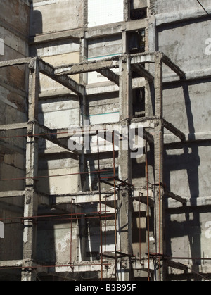 old derelict abandoned block building in athens, greece - Stock Photo