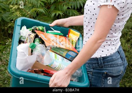 recycle recycling kerbside kerb side green box bin trash rubbish bin reusable taking out the bins boxes - Stock Photo