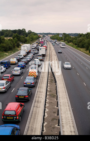 Traffic congestion due to an accident on the M11 motorway heading north between J7 Harlow and J8 Stansted Airport - Stock Photo