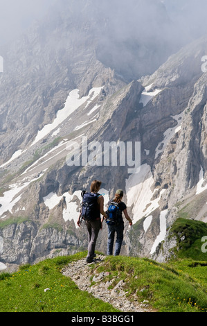 Two female hikers on trail of Mittenwalder Hoehenweg in Karwendel group of Northern Limestone Alps, Mittelwald, - Stock Photo