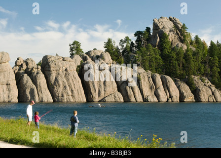 a family fishing on Sylvan Lake in the Black Hills of South Dakota Summer 2007 - Stock Photo