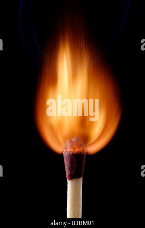 Lit wooden matches burning down slowly - Stock Photo