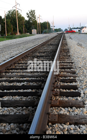 Rural railroad tracks for passenger and freight trains, rail travel - Stock Photo