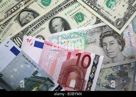 Bank notes from UK, USA, EURO representing world power - Stock Photo