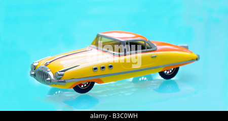 A toy car on a blue surface - Stock Photo