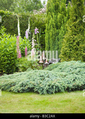 Toadstool statues in a garden - Stock Photo