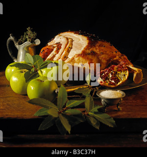 Ham and apples on a table - Stock Photo