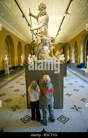 England, London, Victoria and Albert Museum. A brother and sister look up at a classically carved statue in the - Stock Photo