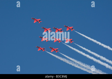 The Red Arrows flying display - Stock Photo