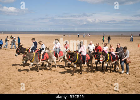 Donkey Rides on Beach at Skegness Lincolnshire UK - Stock Photo