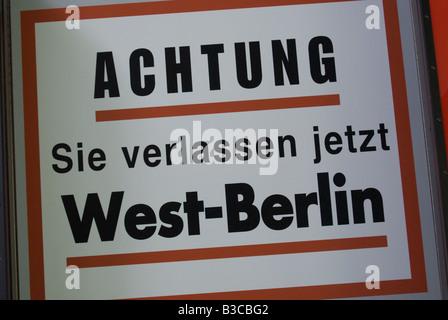German Language Warning Sign on Leaving West Berlin - Stock Photo