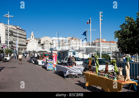 People on the waterfront promenade with market stalls in - Promenade bateau marseille vieux port ...