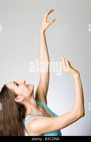 Young woman smiling, side view - Stock Photo