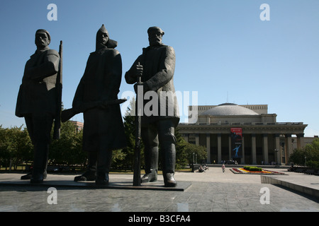 Soviet era statues on Lenin Square in front of Novosibirsk opera and ballet theatre in Novosibirsk, Russia - Stock Photo
