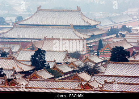 China, Beijing. Snow covered Forbidden City Palace Museum - UNESCO World Heritage Site. - Stock Photo