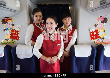 China, Beijing. Chinese New Year - Flight attendants on a New Years Eve flight carrying passengers back to their - Stock Photo