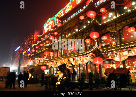 China, Beijing. Chinese New Year Spring Festival - lantern decorations on a restaurant front. - Stock Photo