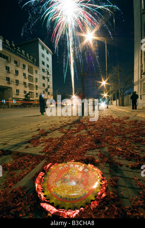 China, Beijing. Chinese New Year Spring Festival - fireworks being let off in the street. - Stock Photo