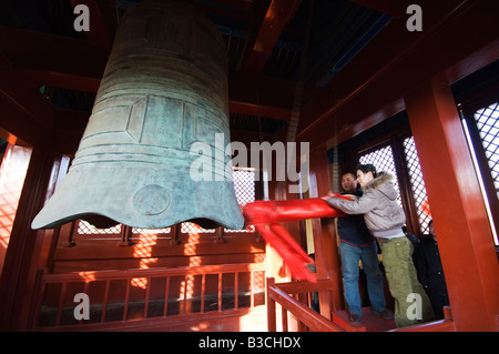 China, Beijing. Chinese New Year Spring Festival - a couple celebrating the new year ringing the Big Bell at Ditan Park temple