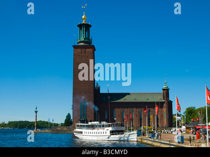 Boat anchored in front of Town Hall in Stockholm Sweden Europe - Stock Photo