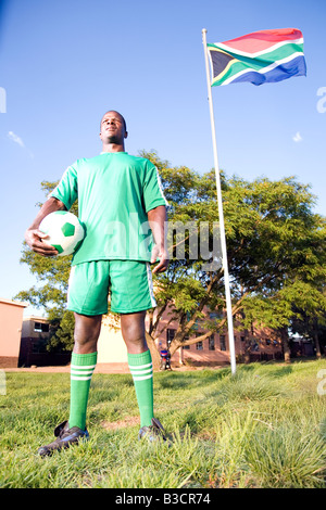 Monkeyapple  aFRIKA Collection  Great Stock ! Soccer player posing with ball under South African flag - Stock Photo