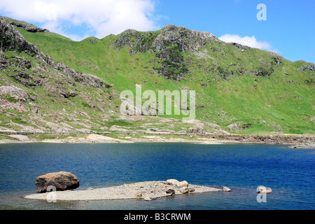 Looking across Llyn Llydaw towards the Crib Goch ridge beside the Miners Track on Mount Snowdon in North Wales - Stock Photo