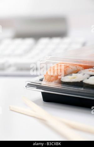 Sushi lunch at work - Stock Photo