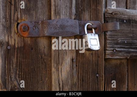 Locked door, close-up - Stock Photo