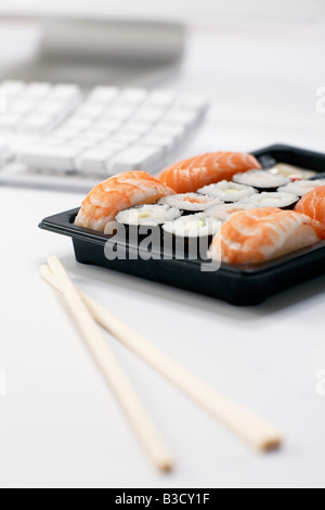 Sushi lunch at work place - Stock Photo
