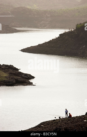 Spain, Canary Islands, Gran Canaria, anglers on lakeshore - Stock Photo