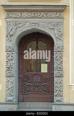 decorated entrance door of Kamienica Pod Gwiazda House under star Rynek Staromiejski Old Town Square Torun Pomerania - Stock Photo