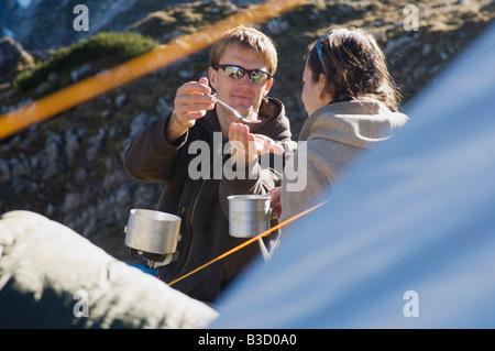 Austria, Salzburg County, Young couple taking a break - Stock Photo
