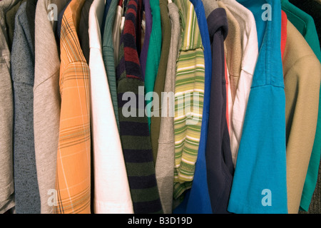 Shirts on hangers in store - Stock Photo