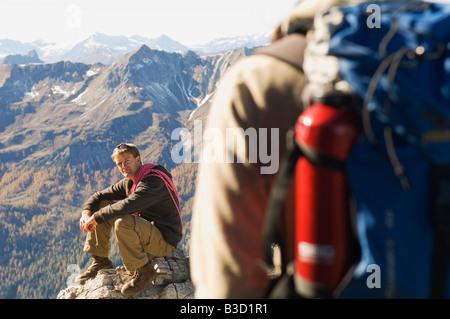 Austria, Salzburg County, Young couple hiking - Stock Photo