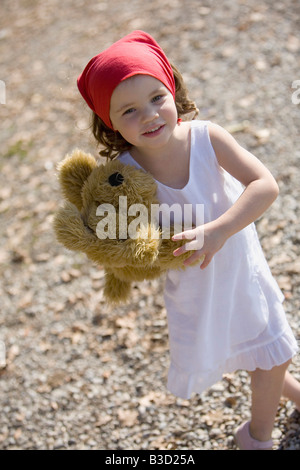 Germany, Bavaria, Ammersee, little girl (3-4) with teddy bear