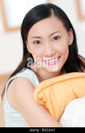 Young woman smiling, portrait - Stock Photo