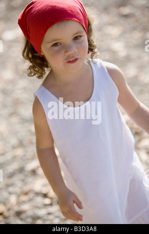 Germany, Bavaria, Ammersee, little girl (3-4) playing on beach