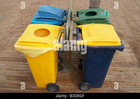 Wheelie bins for plastic, glass, paper and general rubbish on beach on Gran Canaria in The Canary islands - Stock Photo