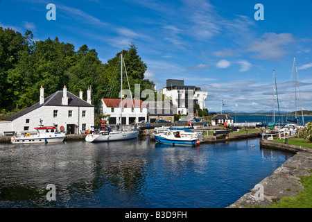 Sailing ship entering the last lock on its westward journey in the Crinan Canal at Crinan in Argyll Scotland - Stock Photo