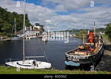 Sailing ship has just entered the canal basin at Crinan in Argyll Scotland - Stock Photo